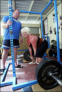 POWER lifters Dean and Vicki Cowan equalled or broke national and world records at the Australian Championships in Brisbane,