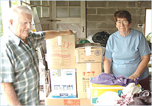 POURING IN: Bernie and Collette Barron with clothes and goods donated to the tsunami appeals.