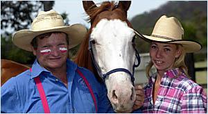 RODEO clown and zebra trainer Ian Bostock and stunt double Laura Haigh at Cabarita yesterday