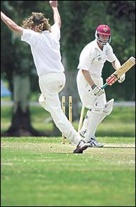 New South Wales bowler Duncan McIlveen celebrates his second dismissal.