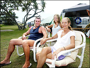 Chris, Hollie and Jan Garvey from Brisbane, enjoying their laid-back holidays at the Hastings Point headland yesterday.