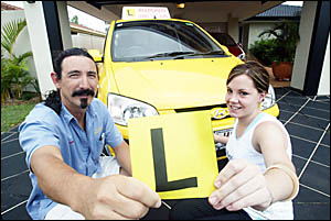 Allroads Driving School director Darryl Porter and learner driver Ange Duvall support Queensland Government?s L-plate trial.