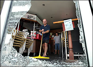 ABOVE: Galileo?s owner Steve Wilkinson mans the broom prior to reopening his restaurant.