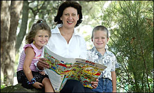 RICHMOND MP Justine Elliot reads a copy of the Big Australia Day Book to her children Joe and Alexandra