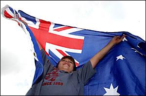 Kurt Miller, 11, of Maclean, holds high his Australian flag.