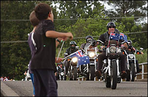 Children from across the Lower Clarence watch as a procession of motorbikes comes into Brushgrove.