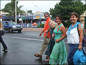 Katharine Myres with tourists at the Byron Visitor Centre