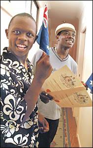 DOUBLE THE JOY: Goonellabah twins Mbatha, left, and Anthony Nguta, 19, from Kenya, celebrate becoming Australian citizens