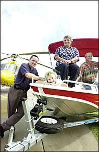 Philip Gibson, left, presents Tahlia Gill, her grandmother  Yvonne Gill and husband Ralph Gill with a new runabout.