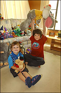 GIFT FROM THE HEART: Michael Kempshall, 3, and Max Skipper, 7, with some of the toys they are giving to tsunami victims.