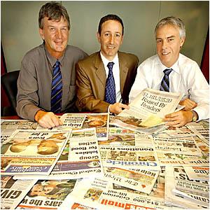 Peter Owen, Robert Glasser and Martin Simons at yesterday?s tsunami-fund handover.
