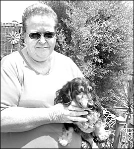Evans Head resident Pat Clark with her dog, Sassy, who raised the alarm when a fire broke out in their neighbour?s home.