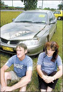 Ellangowan couple Geoff and Julie-Ann Silvey, with their badly damaged car.