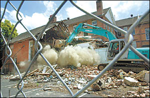 The scene at the Northern Rivers Conservatorium yesterday as demolishers tore down a section of the historic building.