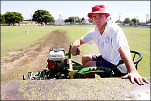 ANNOYED: Ellem Oval curator John Holmes inspects the damage done to the wicket by vandals on Thursday night.