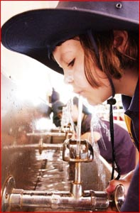 Rockville State School Year 2 pupil Sarah Neuman cools down at the bubbler yesterday. Picture: KEVIN FARMER
