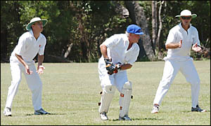 INTENSE: Harwood skipper Tim McMahon, centre, cleans up behind the stumps against South Services last week.