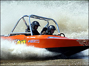 Driver Brett Schumacher and navigator Danny Cochran charge in their boat Swamp Rat.