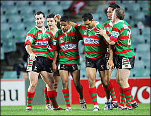 South Sydney?s Roy Bell, third from left, is congratulated by team-mates after scoring against the Broncos in August 2004.