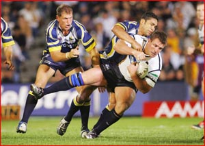 Shane Webcke is dumped  during last year?s NRL semi-final match at Dairy Farmers Stadium. Picture: AAP IMAGE