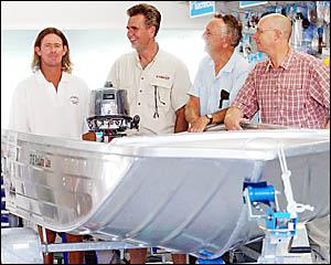 Winner Jason Sheehan, left, with sponsor Stephen Behn, fishing columnist Dick Richards and Examiner editor Peter Ellem.