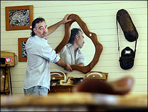 Rikc Burnell arranges furniture to go on display at the former Norco Rural Store on Tweed Valley Way, Murwillumbah.