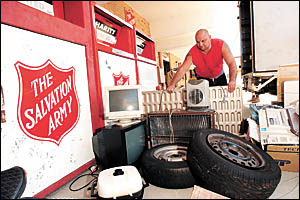 Stop the rot . . . volunteer Graham Ettridge sifts through the ?dump? outside the Salvation Army Red Shield Family Store.