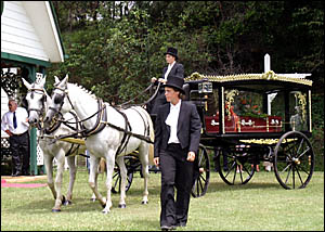 A horse-drawn hearse driven by Cassandra Wanless with foot person Leanne Hudson symbolised Barry Masterson's love of horses.