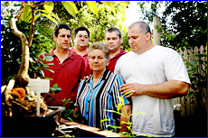 Ellen Sharp surrounded by her four sons from left Barry, Glen, Greg and Allan are mourning Ray'death.