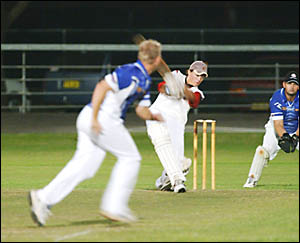Matt Kroehnert was again in devastating form for South Services on Friday night. Here, he takes to the bowling of Brett Baxter.