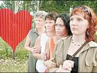 SIMONE MOURNED: Standing close to a large red heart