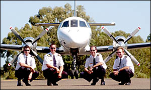 FLYING HIGH: First Officer Andrew Wright, left, Captain James Geitz, Captain James Dowland and First Officer Nick Gerathy