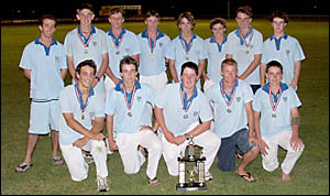 INNING FEELING: The Grafton High Open boys cricket team celebrates its Daily Examiner shield win on Wednesday night.