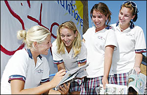 TOP surfer Stephanie Gilmore?s schoolwork involved signing autographs for fans yesterday following her Roxy Pro win