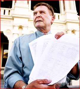 Dan Sayer displays the petitions calling for the banning of adult entertainment in the city. Picture: KEVIN FARMER