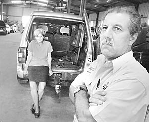 TARGETED: Eric and Margaret Box at their Casino business premises, Eric Box Mitsubishi & NRMA, with the car that was stolen