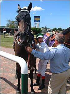Jockey Ryan Plumb gives trainer and father Lyle Plumb the lowdown after riding Octagonal?s Star.