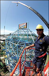 Shane Clouten has a bird?s-eye view as he oversees the removal of the Aquajet waterslide.