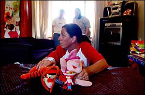 Coeliac sufferer Brenda Saye, watches as her son Brody Watkins illustrates one of the problems of coeliac disease.