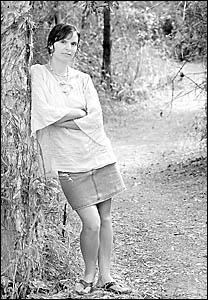 CONCERN: Byron resident Syama Priya, behind her the path leading through the Sandhille Estate to Clarkes Beach.