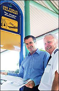 Lismore council traffic and law enforcement co-ordinator Bill McDonald explains the new bus signs to coach driver Athol Lavis.