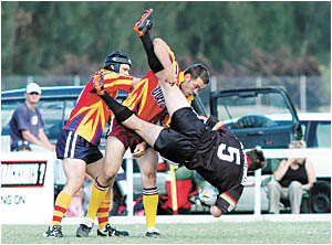 Sawtell winger Dennis Gordon comes in for some heavy treatment.
