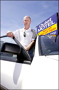 Len Bogaards, owner of Ballina Travellers Lodge Motel, is worried Ballina Shire Council may ban advertising signs on cars.