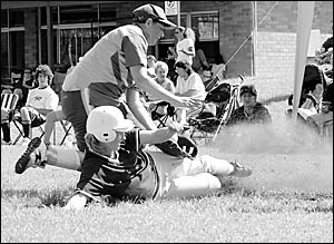 Trudy Cameron (Woolgoolga A reserves) slides into home plate during the grand final match against Dorrigo.