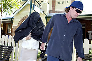ACCUSED kidnapper Emily Meadows tries to hide as she leaves Murwillumbah Court yesterday after being freed on bail.