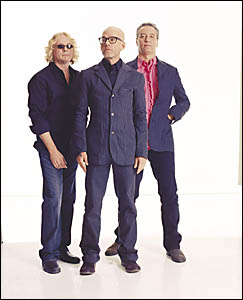 NIGHT SWIMMING: REM, from left, Mike Mills, Michael Stipe and Peter Buck, are headlining this year?s Bluesfest.