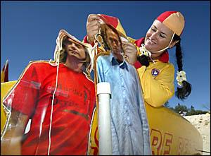 TYALGUM?S Michelle Van den Broek dresses up cardboard cutouts of Triple J?s breakfast hosts Jay and The Doctor