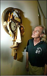 TWEED River Art Gallery tech officer Barry Mossop checks out a piece by Brisbane artist John Morris.