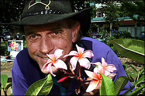 FRANGIPANI Man, Michael ?DJ? Earnshaw, with Dean Conkin variety flowers yesterday at the Coolangatta Markets.