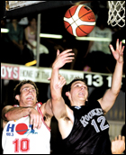 Peter Trenerry (right) soars high.